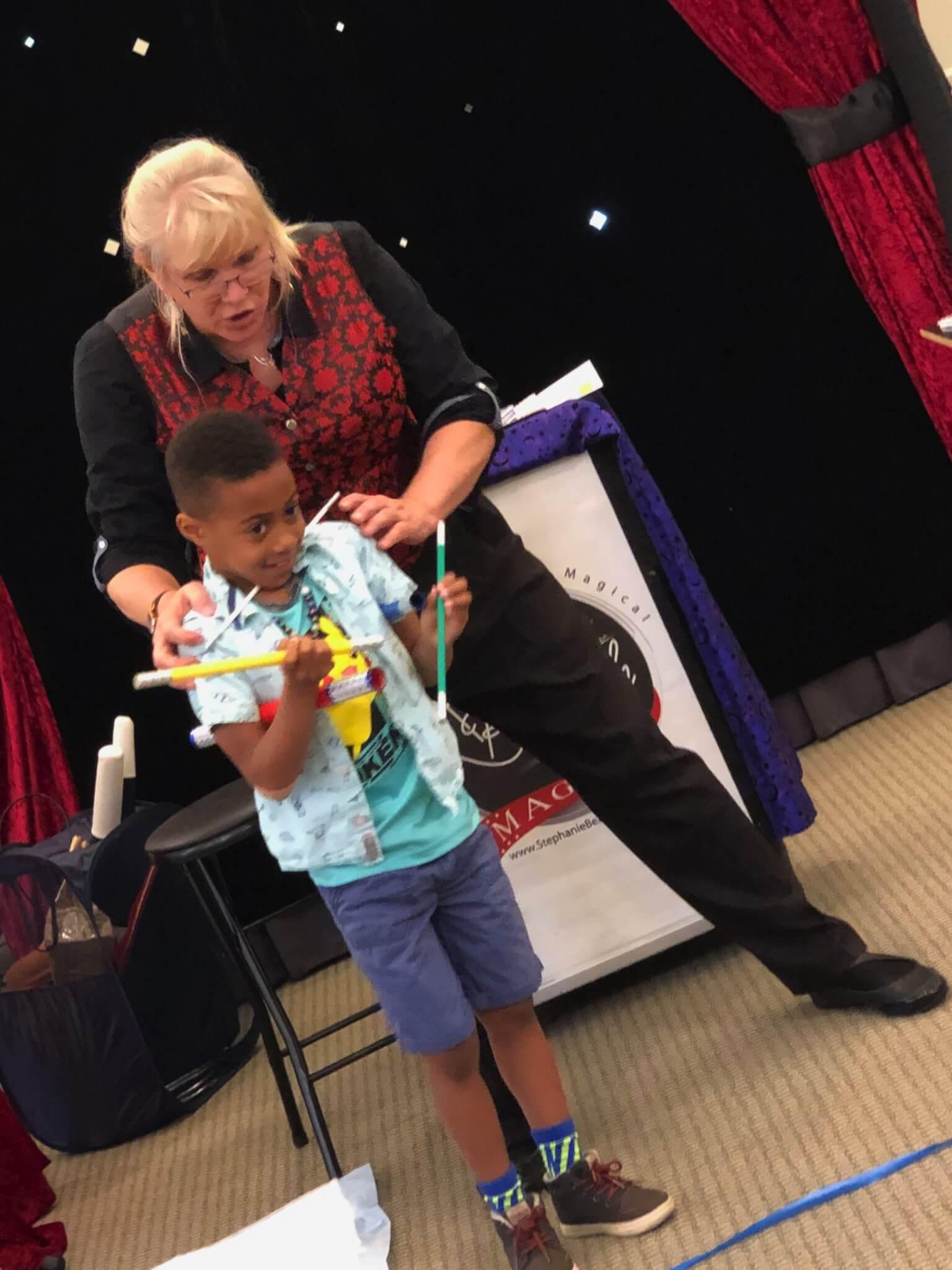 Stephanie Beach entertains during a birthday magic show.