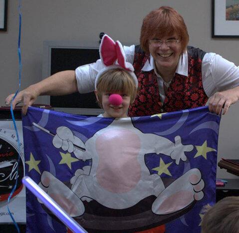 Stephanie Beach works some magic at a child's birthday.
