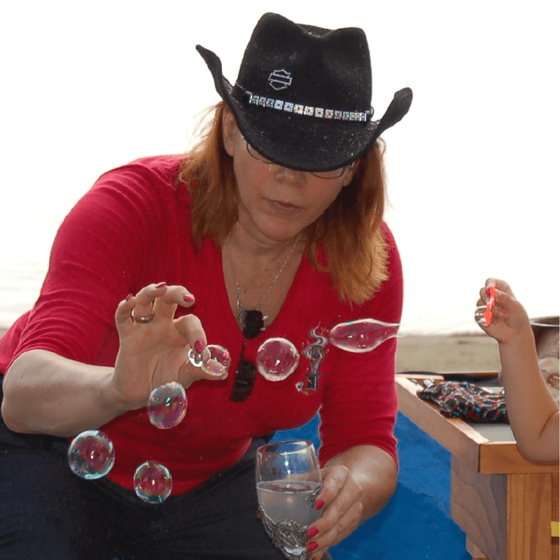 Magician Stephanie Beach performs some magic with bubbles.